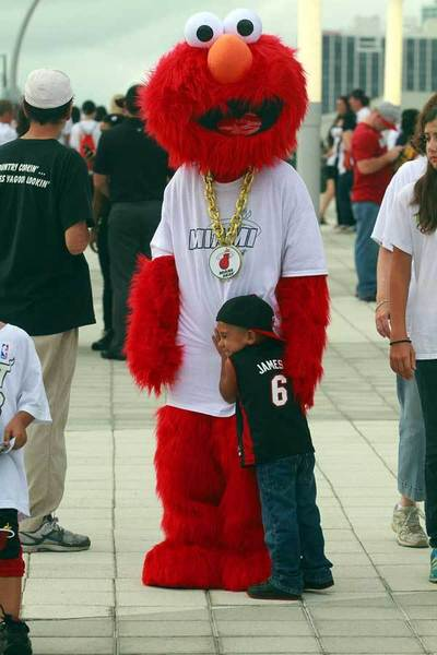 Miami Heat fanPeyton Holton, 4 hugs Elmo in front of the American Airlines Arena before game 5 of the NBA finals.