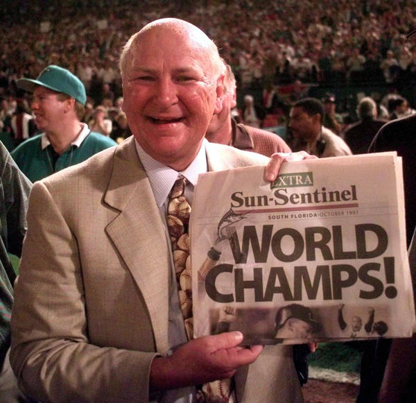 Owner H. Wayne Huizenga is all smiles after his five-year-old team shocked the baseball world by beating the Cleveland Indians 4-3 in 11 innings in Game 7 in Miami Gardens.