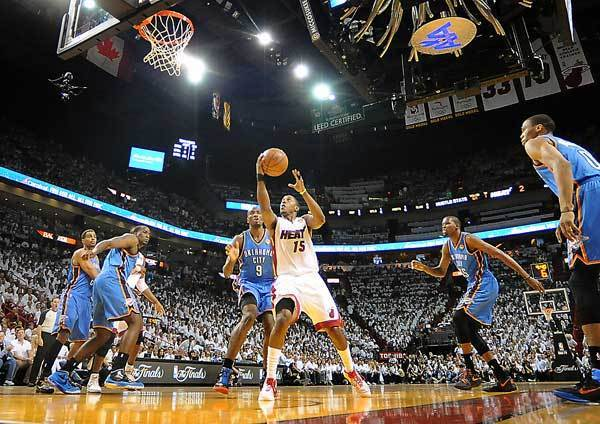 Miami's Mario Chalmers drives to the basket between a sea of Oklahoma defenders.