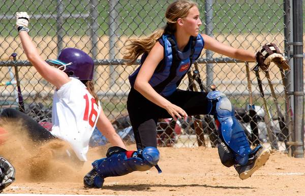 Lehigh Valley's Lizzie Deutsch, from Nazareth High School, at catcher, gets the throw too late to tag Suburban 1's Vicky Tumasz, of North Penn High School, in the first game of their double elimination competition during the finals of the Phillies Carpenter Cup Classic at FDR Park in Philadelphia on Thursday afternoon.