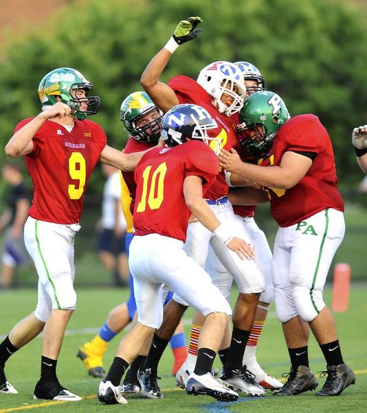 The Red team celebrates a touchdown in the McDonald's All-Star Football Classic at Nazareth High School on Thursday.