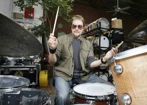 Acclaimed rock drummer Jim Keltner, who has played on major albums by Bob Dylan, John Lennon, Neil Young and many others, sits for a photo at Drum Doctors in Glendale.