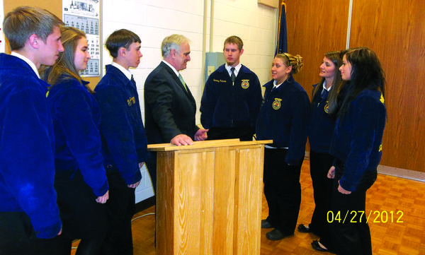 State Department of Agriculture George Greig (center) talks with FFA students (from left): Ryan Horner, Tech Center; Brianna Hoyman, Meyersdale; Blaze Bowers, Tech Center; Jeremy Putman, Tech Center; Ashley May, Abby Noll and Balee Wahl, all from Somerset, during the Education and Business Lunch presented by the Somerset County Chamber of Commerce at the Somerset County Career and Technology Center in late April.