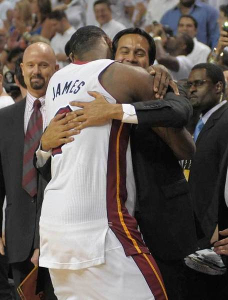 LeBron James hugs head coach Erik Spoelstra in the fourth quarter with the game well in hand. The Miami Heat won Game 5 over Oklahoma City to win the NBA Championship.