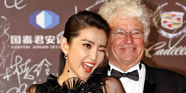 Actress Li Bingbing and French director Jean-Jacques Annaud arrive at the red carpet during the opening ceremony for the 15th Shanghai International Film Festival.