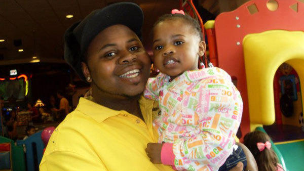 Willie Randall White Jr., 24, with his daughter Paris.