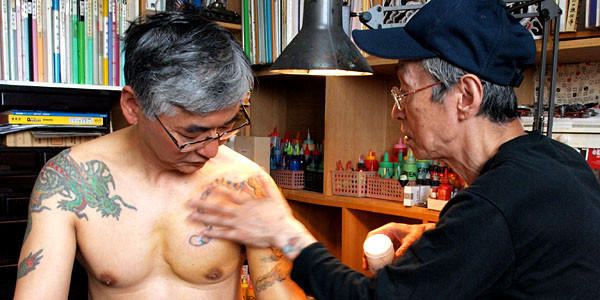 Californian-Japanese businessman Motoyama Tetsuro is tattooed by Japanese tattoo master Horihide, right. In Horihide's studio (actually the back room of his house).