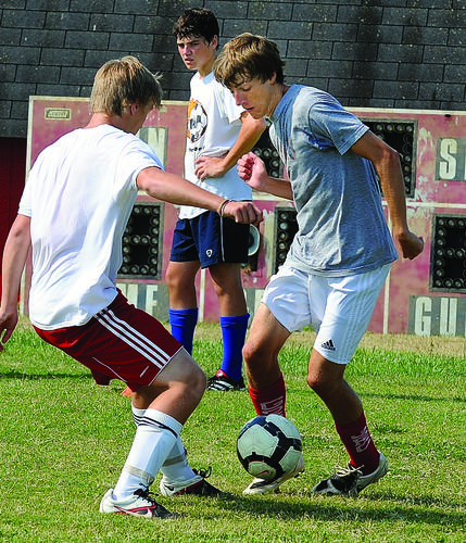 Austin Golden, left, takes a defensive position on Andrew Walker during a drill to teach the players how to take space and defend against the overlapping run on goal. Golden will be a sophomore and Walker a senior this fall at GRC.