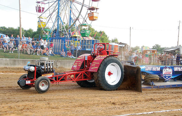 Jeff Hartley of Paris is first on the track driving his tractor Return of the Spirit during the tractor pulling contest at the Fair Thursday.