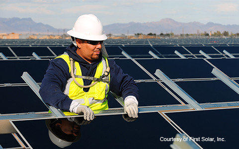 A worker at a First Solar site in Blythe that is separate from the Antelope Valley Solar Ranch One project.