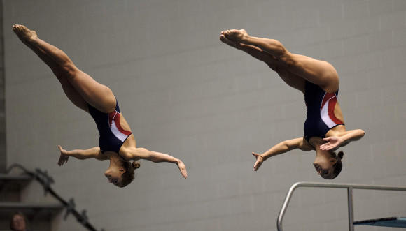 Kassidy Cook (L) and Christina Loukas in the synchro final at the 2012 Olympic diving trials.
