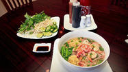 You can't judge an eatery by its exterior. Pho Vinh Vietnamese restaurant is a prime example. The plain exterior, the side-street location and the worn parking lot hardly beckon passersby to pull in.