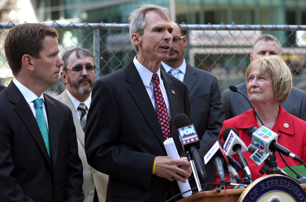 Rep. Dan Lipinski (D-Ill.), center, urges members of Congress to support a transportation reauthorization bill at a news conference in downtown Chicago today. Joining him are Rep. Robert Dold (R-Ill), left, and Rep. Judy Biggert (R-Ill), right.
