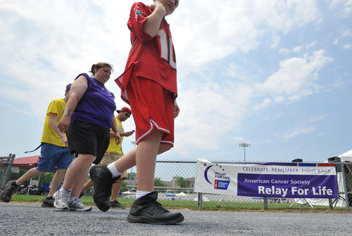 People walk during the 24-hour Whitehall-Coplay Relay for Life on Friday afternoon. The walk this year is held in memory of Hannah Bankos, a Whitehall junior who died in February after battling leukemia.  Eberhart Motors donated a car during the event to be filled with donated paper products, such as paper towels, toilet paper and more that will be given to Hope Lodge, a residence in Cheltenham where cancer patients and their caregivers can stay while in the area for treatment.