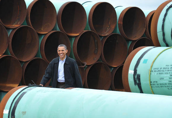 President Obama arrives to speak at the TransCanada Stillwater pipe yard in Cushing, Okla., on March 22, where he promised to expedite construction of a new pipeline from Cushing to the Gulf Coast. Permits for that project could be issued as early as Monday.