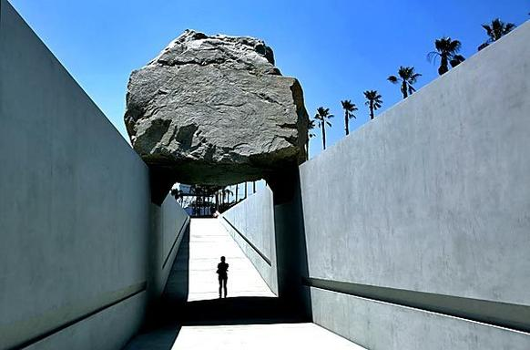 "Michael Heizer's ""Levitated Mass,"" the commissioned sculpture at the Los Angeles County Museum of Art,  gives visitors the chance to walk underneath a 340-ton granite boulder.  The sculpture opens to the public on June 24."