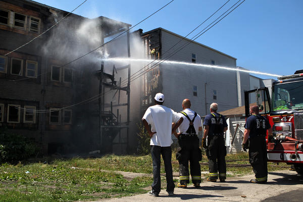 Firefighters extinguish a two-alarm fire in the 6200 block of South King Drive in Chicago on Friday.