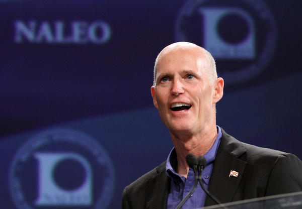 Gov. Rick Scott addresses the National Association of Latino Elected and Appointed Officials conference, Friday, June 22, 2012, at the Contemporary Resort at Walt Disney World, in Lake Buena Vista, Fla. President Obama was scheduled to address the crowd later in the day.