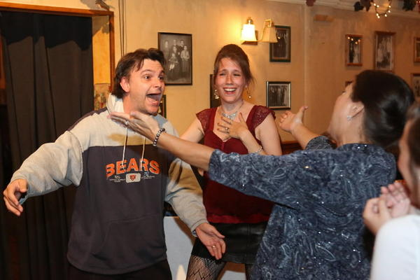 "Johnny Boy (Eddie Domingues) is greeted by his wife Angie (Jamie Brouillette) and mother, Renata (Nancy Barenbrugge) in ""Johnny Boy's Graduation,"" an interactive comedy produced by Mark Nassar where patrons go to a graduation party at Boni Vino Ristorante."
