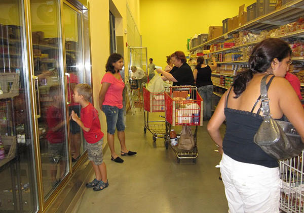Customers browse the new Loaves & Fishes pantry in Naperville.