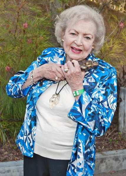 Actress Betty White, a devoted zoo supporter, with a scaly friend at the Los Angeles Zoos Beastly Ball.