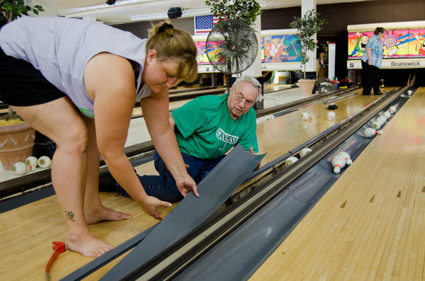 Ronda Turcotte and Richard Turcotte start pulling up the lanes at Highland Bowl on Farmington Ave. in Hartford. Cheryl Turcotte can be seen in the background.