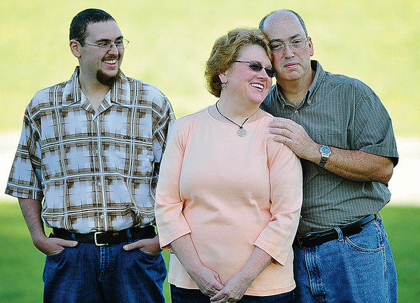 Matthew, left, Michelle and John Hoover each had bariatric surgery. They have lost a total of more than 450 pounds.