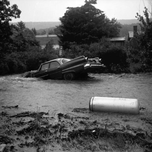 Tropical Storm Agnes, which hit Pennsylvania June 22, 1972, was the worst natural disaster in the state's history, causing $2.1 billion damage. A car and a gas tank are no match for the flood's current as it rushes through Middleport, Schuylkill County.