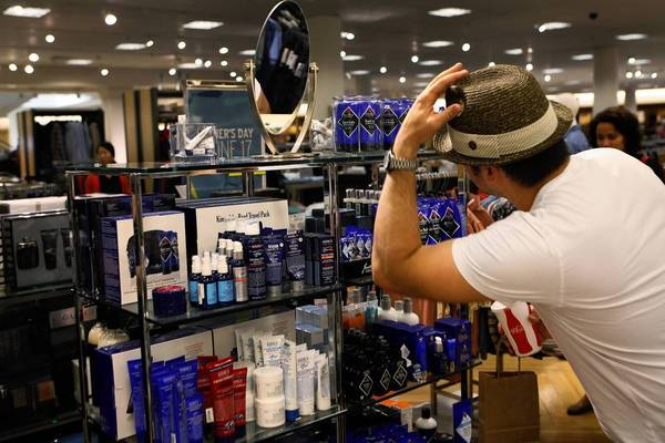Geoff Warner, 38, of Los Angeles checks out his look in Nordstrom at the Grove shopping center. Nordstrom began shifting its male grooming items out of the beauty department last fall and into the men's furnishings area.