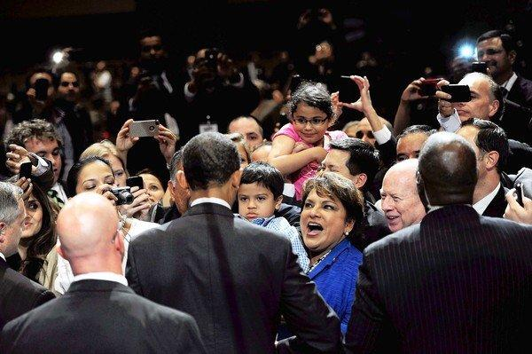 President Obama, his back turned, greets attendees at the annual conference of the National Assn. of Latino Elected and Appointed Officials.