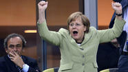 Angela Merkel celebrates Germany's win over Greece
