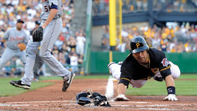 Pittsburgh Pirates' Rod Barajas scores after a throwing error by Detroit Tigers starting pitcher Doug Fister during the second inning of a baseball game Friday.