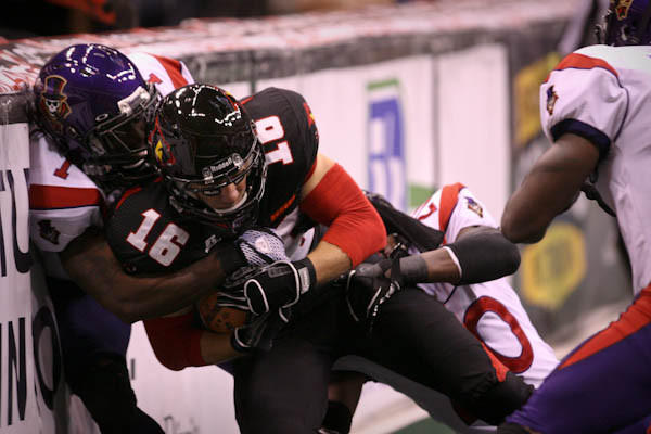 "<a class=""taxInlineTagLink"" id=""ORSPT000209"" title=""Orlando Predators"" href=""/topic/sports/football/orlando-predators-ORSPT000209.topic"">Predators</a> WR Glen Fox (16) is brought down on the sideline by New Orleans' Demarcus Robinson (1) and Jeremy Kellem (20) during first quarter action of an <a class=""taxInlineTagLink"" id=""ORSPT000454"" title=""Arena Football League"" href=""/topic/sports/football/arena-football-league-ORSPT000454.topic"">AFL</a> game against the New Orleans VooDoo at the <a class=""taxInlineTagLink"" id=""PLREC000041"" title=""Amway Center"" href=""/topic/sports/amway-center-PLREC000041.topic"">Amway Center</a> in Orlando, Fla. on Friday, June 22, 2012. (Joshua C. Cruey/Orlando Sentinel)"