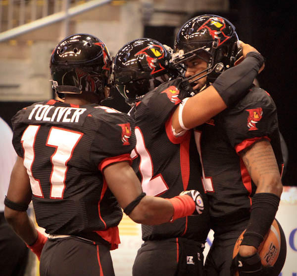 "<a class=""taxInlineTagLink"" id=""ORSPT000209"" title=""Orlando Predators"" href=""/topic/sports/football/orlando-predators-ORSPT000209.topic"">Predators</a> WR Jarvis Williams (11) is congratulated by team mates T.T. Toliver (17) and Chris Leak (12) after scoring a touchdown during first quarter action of an <a class=""taxInlineTagLink"" id=""ORSPT000454"" title=""Arena Football League"" href=""/topic/sports/football/arena-football-league-ORSPT000454.topic"">AFL</a> game against the <a class=""taxInlineTagLink"" id=""ORSPT000466"" title=""New Orleans VooDoo"" href=""/topic/sports/football/new-orleans-voodoo-ORSPT000466.topic"">New Orleans VooDoo</a> at the <a class=""taxInlineTagLink"" id=""PLREC000041"" title=""Amway Center"" href=""/topic/sports/amway-center-PLREC000041.topic"">Amway Center</a> in Orlando, Fla. on Friday, June 22, 2012. (Joshua C. Cruey/Orlando Sentinel)"
