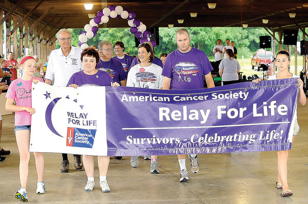 Cancer survivors walk the survivor lap to kick off the Relay For Life of Southern Washington County Friday night at the Washington County Agriculture Education Center near Sharpsburg.