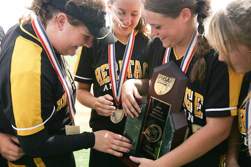 Few schools in Broward County have had as much success in girls sports as American Heritage. The Patriots have become regulars at the state soccer tournament, state softball tournament, state swim meets, state golf and state track meets. Here, members of the 2009 state championship softball team admire their trophy.