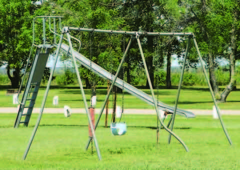 The playground equipment at Leola City Park has fallen into a state disrepair, but is not a top priority for parks committee members since less people frequent the area. American News Photo by Kay Nguyen