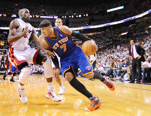 The Heat's stifling defense opens the playoffs by holding Carmelo Anthony and Amare Stoudemire to a combined 20 points on 5-for-22 shooting.