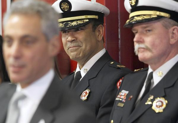 Mayor Rahm Emanuel praises outgoing Chicago Fire Department Commissioner Robert Hoff, right, while appointing Jose Santiago, center, as his replacement in February. Before his resignation, Hoff spoke out strongly against any staffing reduction.