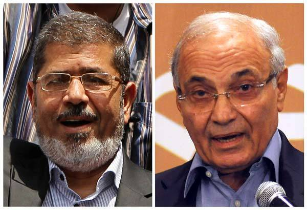Combination photograph of Muslim Brotherhood's presidential candidate Mohamed Morsy and former prime minister and current presidential candidate Ahmed Shafik in Cairo.