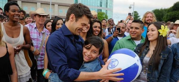 "Ryan Seacrest greets the crowd June 14 at San Antonio auditions for ""American Idol"" at the Alamodome."