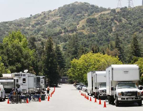 A caravan of production vehicles line up in the parking lot at Descanso Gardens in La Canada Flintridge for the filming of a McDonald's commercial.