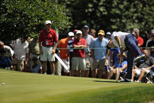 Notah Begay III uses some body english as he just misses a birdie putt on the 9th hole, his last, during the conclusion of the second round of the 2012 Travelers Championship golf tournament at the TPC River Highlands in Cromwell Saturday morning. Had Begay, the 2000 Greater Hartford Open winner, made the putt he would have been around for the weekend pairings but he missed the cut on that miss.