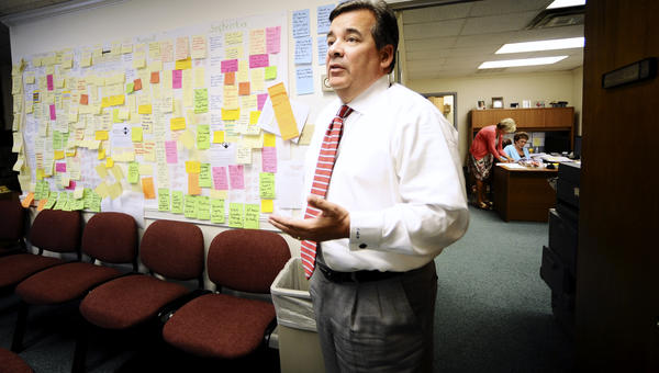 Washington County Superintendent of Public Schools Clayton Wilcox stands by a board filled with new ideas.