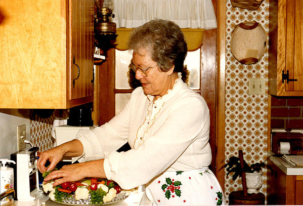 Frankie Everline prepares food for a Christmas feast in 1986, about a week before she had a stroke.