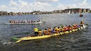 Dragon boats race in harbor
