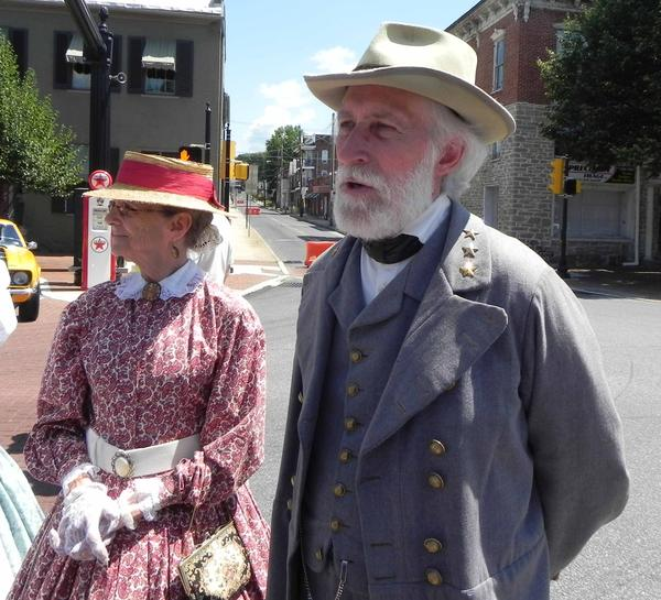 Shirley Stone, West Virginia, portraying Mrs. George Davis, stands next to Gen. Robert E. Lee portrayed by Stone's husband, Al Stone of West Virginia, after he gives his address in Waynesboro in conjunction with Cruizin' Day on Saturday.