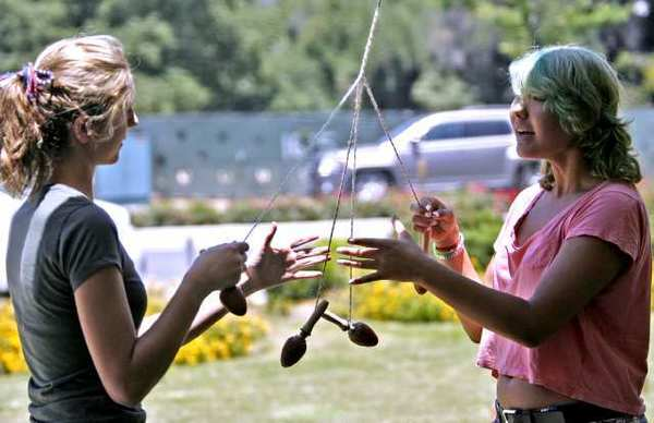 Shayna Niles, left, and Alia Spring, both 17 and from Granada Hills, make a Viking Whip Cord during the annual St. Hans Day Picnic of the Edgar Grieg Lodge of the Sons of Norway held at Lutheran Church of the Foothills in La Canada Flintridge.