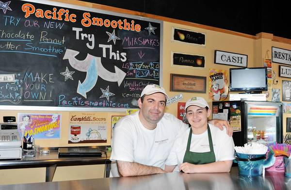 Owners Giorgi and Erna Kavelidze pose in Pacific Smoothie on 333 S. New Street on Southside Bethlehem. The smoothie shop features 20 flavors of all natural organic smoothies as well as milkshakes.