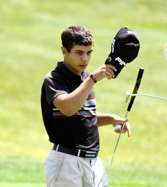 Evan Notaro of Moore Twp. tips his hat after his last shot of the day, a putt on 18 at Woodstone. Notaro won the Medal Play tournament.